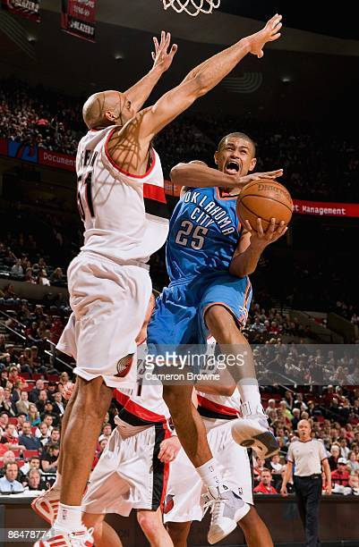 Earl Watson of the Oklahoma City Thunder goes to the basket under pressure against Michael Ruffin of the Portland Trail Blazers during the game on...