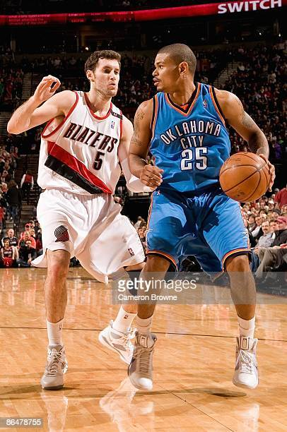 Earl Watson of the Oklahoma City Thunder handles the ball against Rudy Fernandez of the Portland Trail Blazers during the game on April 13 2009 at...
