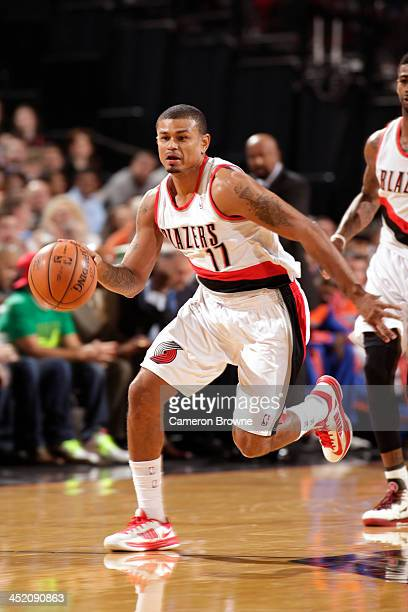 Earl Watson of the Portland Trail Blazers brings the ball up court against the New York Knicks on November 25 2013 at the Moda Center Arena in...