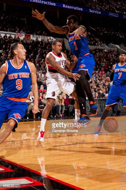 Earl Watson of the Portland Trail Blazers passes the ball against the New York Knicks on November 25 2013 at the Moda Center Arena in Portland Oregon...