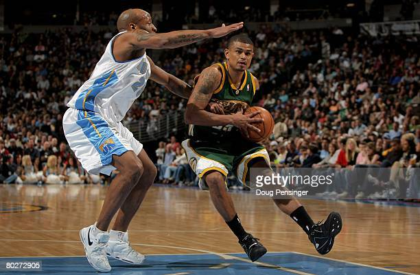 Earl Watson of the Seattle SuperSonics drives the ball against Anthony Carter of the Denver Nuggets at the Pepsi Center on March 16 2008 in Denver...