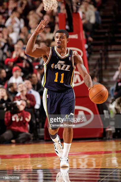 Earl Watson of the Utah Jazz calls a play against the Portland Trail Blazers during the preseason game on December 19 2011 at the Rose Garden Arena...