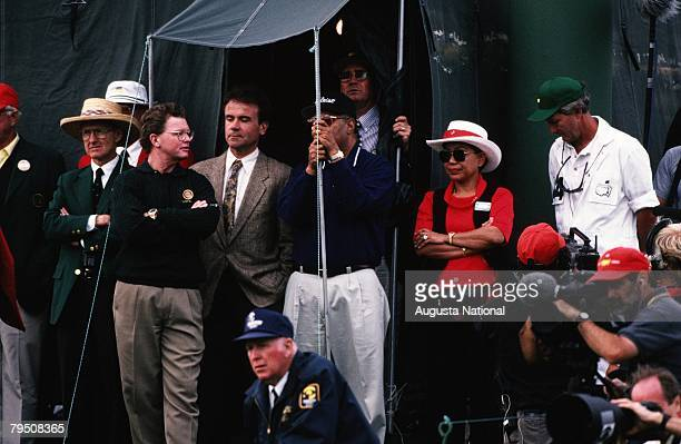 Earl Woods And Kutilda Wait On The 18th Hole During The 1997 Masters Tournament