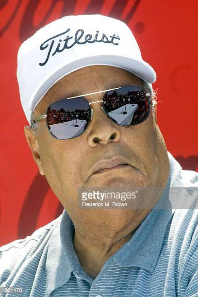Earl Woods the father of golfer Tiger Woods sits during the Coca Cola/Tiger Woods Foundation Junior Golf Clinic April14 2001 in Long Beach CA