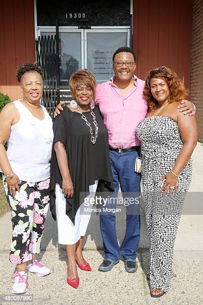 Earline Franklin talk show host Mildred Gaddis Judge Mathis and his wife Linda Mathis poses at Mathis Community Center on July 26 2015 in Detroit...