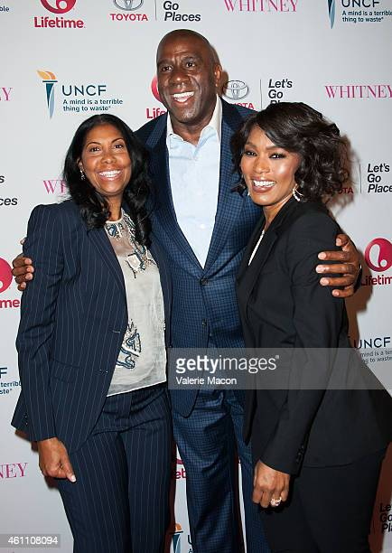 Earlitha Kelly Magic Johnson and Angela Bassett arrive at the Premiere Of Lifetime's Whitney at The Paley Center for Media on January 6 2015 in...