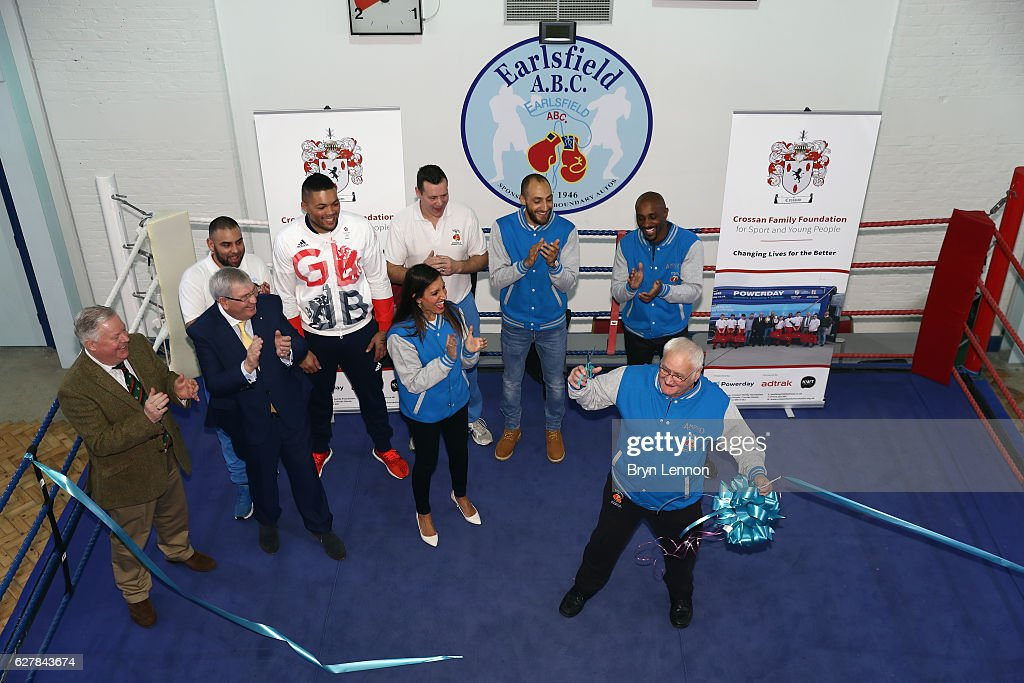 Earlsfield ABC Coach Bob Pearson cuts the ribbon to reopen the Earlsfield Amateur Boxing Club on December 5, 2016 in London, England.