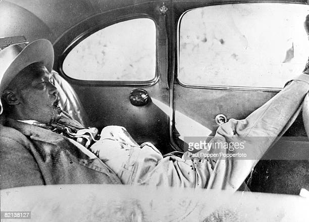 Early 1950's Kenya Chief Waruhiu lying dead in his Hudson car after he had been shot by the Mau Mau tribe