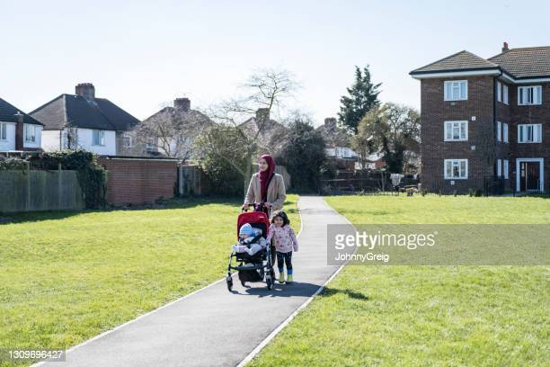 early 30s british asian woman exercising with young children - religious dress stock pictures, royalty-free photos & images