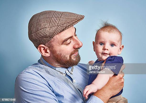 Early 30's British male holding infant son