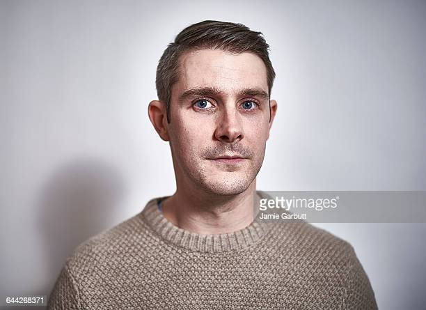 early 30's british male with a proud expression - serio fotografías e imágenes de stock