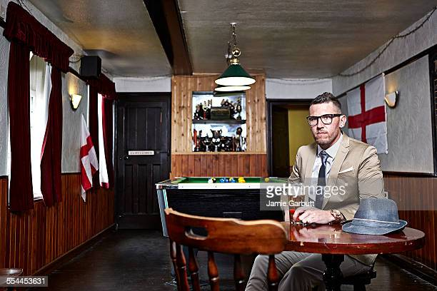 Early 30's male sat in a traditional British pub