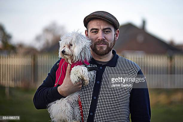 Early 30's male stood with his dog