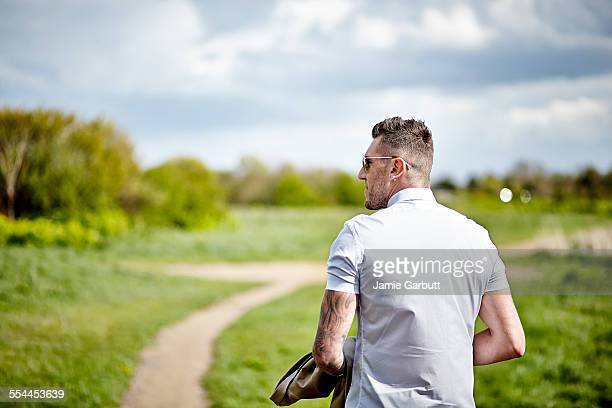 Early 30's male taking a walk in the countryside