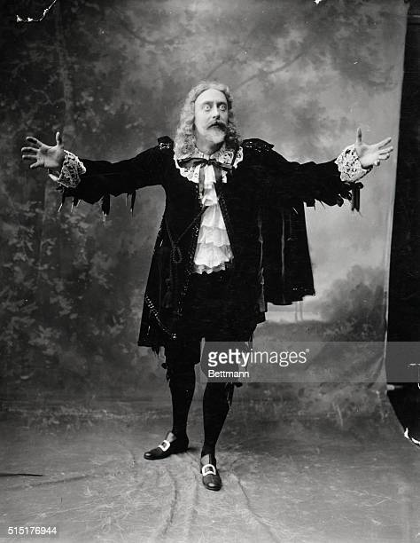 Early actor in Shakespearean costume emoting making gesture with arms extended Undated photograph