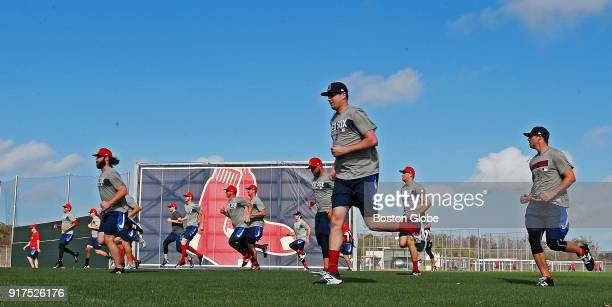 Early arrivals to Boston Red Sox spring training camp prepare for workouts during spring training at the Player Development Complex at Jet Blue Park...