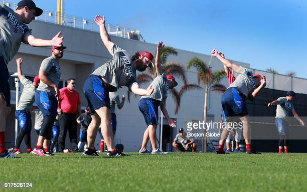 Early arrivals to Boston Red Sox spring training camp stretch before working out at the Player Development Complex at Jet Blue Park in Fort Myers FL...