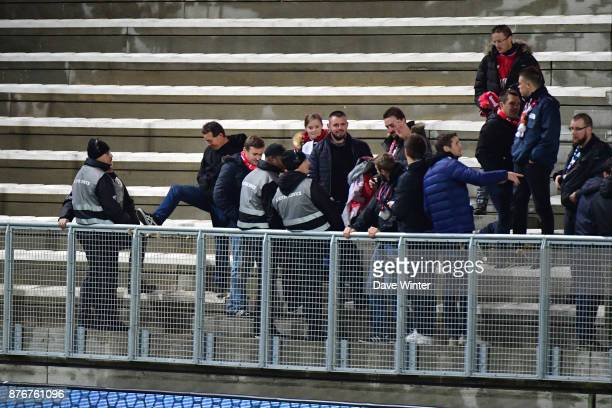 Early arriving Lille fans test the security barrier before the rescheduled Ligue 1 match between Amiens SC and Lille OSC at Stade de la Licorne on...