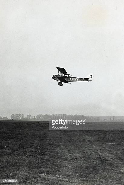 1930 British Aviator Amy Johnson setting out in her small biplane for her lone flight from Croydon to Australia