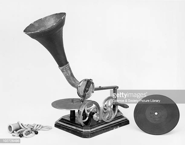 Early Berliner Gramophone Early Berliner Gramophone Early example of a gramophone with ear tubes horn and record made by Berliner