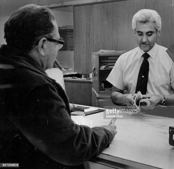 DEC 31 1975 'Early Bird' Customer For 3Cent Stamps Readying for postal rate increase Louis Goldberg employe of Artcraft Sign Co Tuesday bought $18...