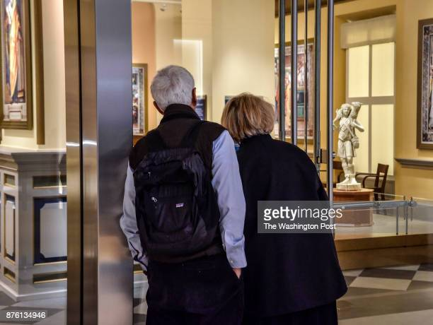 Early bird visitors peer into the Vatican gallery before it has opened during the Museum of the Bible's invitation only grand opening on November...