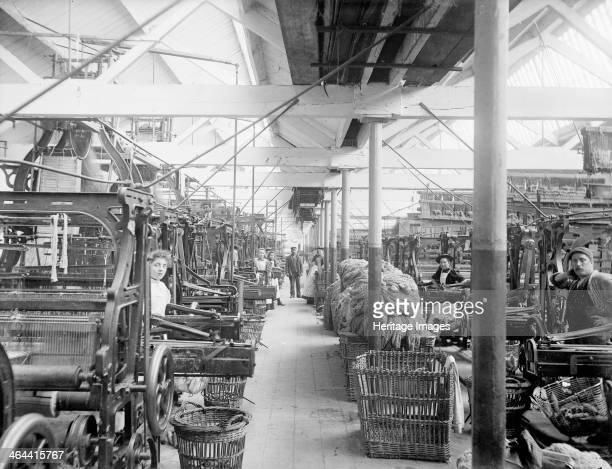 Early Blanket Factory Witney Oxfordshire 1898 The interior of the loom shed with numerous machines and baskets of wool beside them as well as...