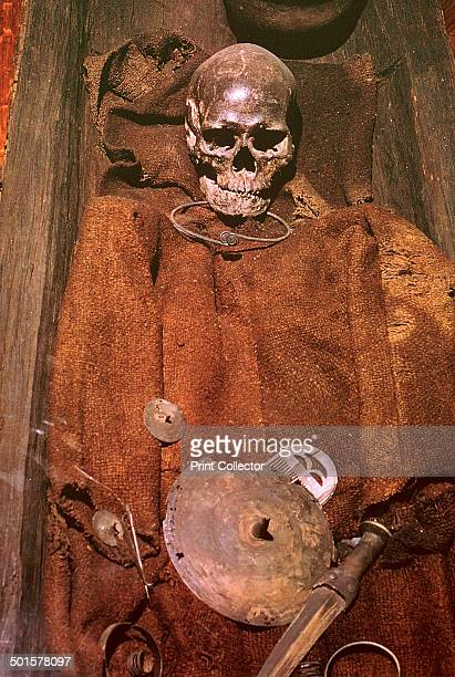 Early bronze age burial from Denmark of a man in an oak coffin in a bog Note the shield and comb he was buried with 16th century