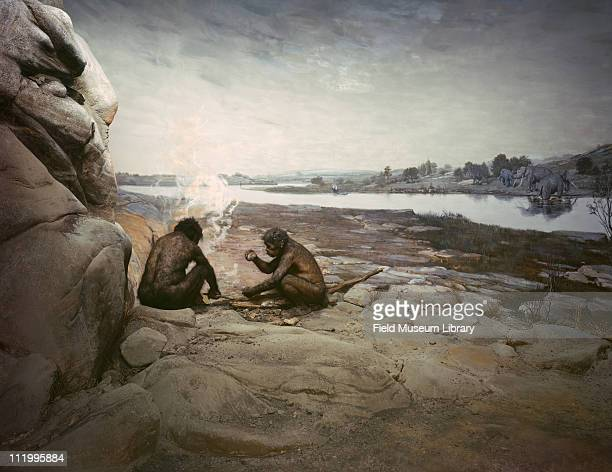 Early Chellean Acheulean scene making fire flints Gargas Cave Northern France Homo erectus in Europe mid to late 20th century On exhibit between 1933...