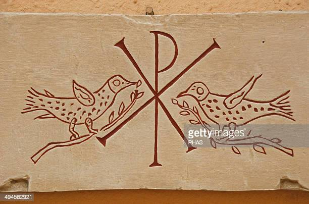 Early Christian Roman tombstone with Christian iconography Monogram of Christ with two pigeons Plaster copy of an original from the Vatican Museums...