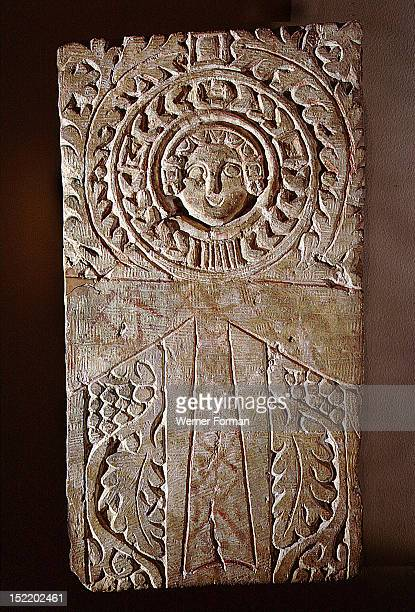 Early Christian stela incorporating a looped cross or ankh symbol surrounded by the vine of eternal life illustrating the fusion of pharaonic...