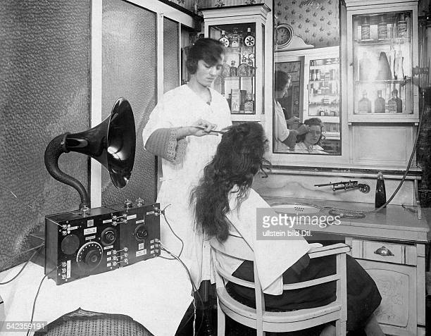 Early days of radio broadcasting listening to music from the radio in a beauty salon Vintage property of ullstein bild