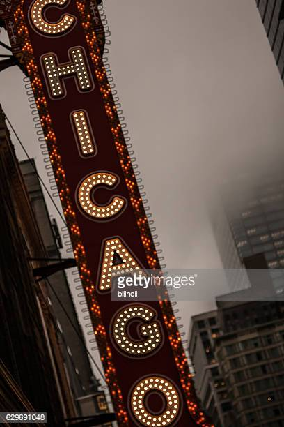 Early evening foggy photo of the Chicago Theatre lighted sign