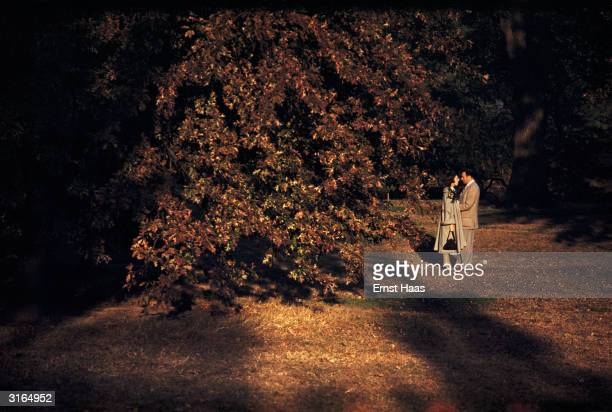 Early evening rendezvous for two lovers in a New York park