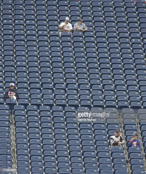 Early fans of the New England Patriots sit among empty seats prior to the game against the Miami Dolphins at Gillette Stadium on October 10 2004 in...