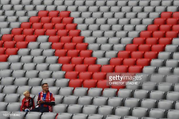 Early fans take their seats hours before kickoff to the German first division Bundesliga football match FC Bayern Munich v TSG 1899 Hoffenheim in...