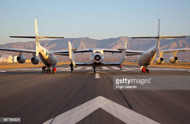 Early flight preparations are made to WK2 and SS2 prior to the first powered flight of Virgin Galactic's SpaceShipTwo on April 29 2013 in Mojave...