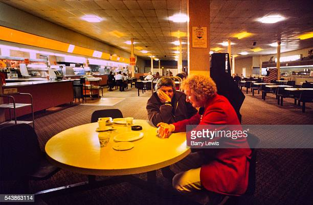 Early hours of Saturday morning in the cafe a redcoat tries to wake up Butlins holiday camp in Skegness Butlins Skegness is a holiday camp located in...