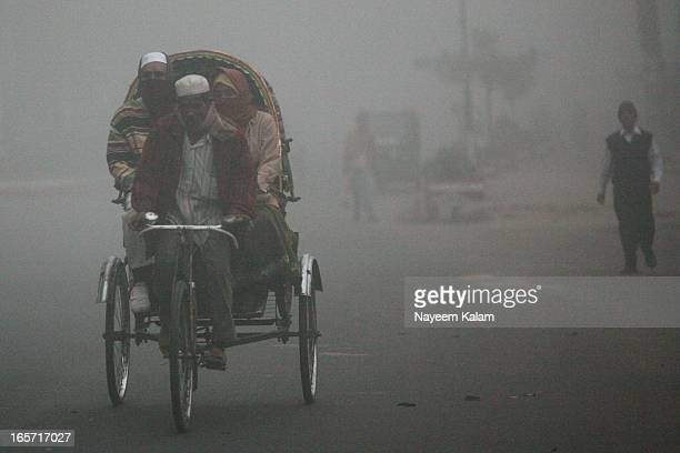 Early in the morning, new year's day.... A rickshaw in the heavy fog. Nor Ahmed Road, Chittagong