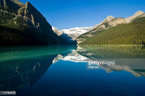 early morning at lake louise, canadian rockies - lake louise stock photos and pictures