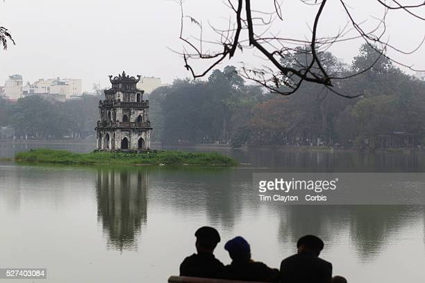 Early morning beside Hoan Kiem Lake Hanoi Vietnam with the Thap Rue Pagoda visible in the distance Hanoi is the capital of Vietnam and the country's...