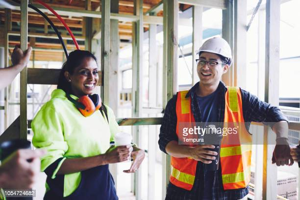 early morning breakfast in the construction site. - headwear stock pictures, royalty-free photos & images