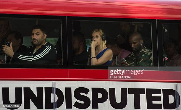Early morning commuters travel on a bus in the City during a tube strike in London on July 9 2015 London's roads buses and overland trains struggled...
