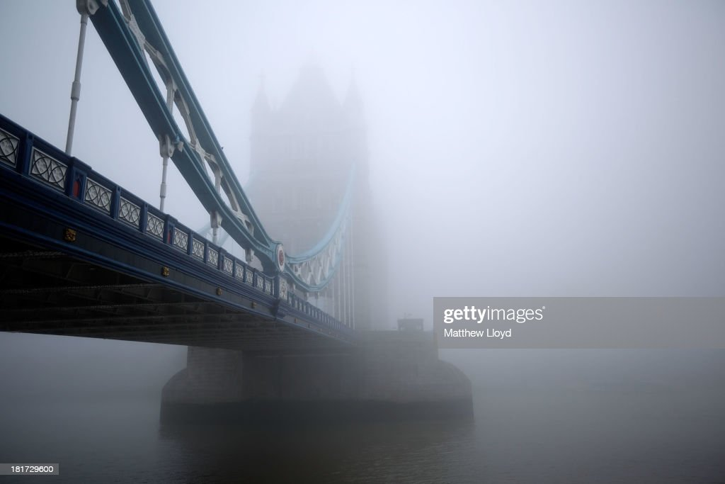 Early morning fog enshrouds Tower Bridge on September 24, 2013 in London, England.