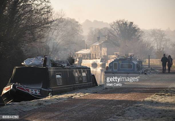 Early morning frost fog and mist lingers as the sun rises over the Kennet and Avon canal on December 29 2016 in Bath England Freezing temperatures...