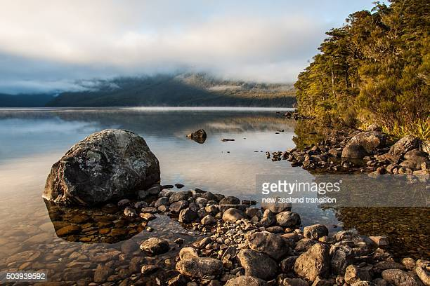 early morning golden sunlight on Lake Rotoiti, Nelson Lakes National Park, New Zealand