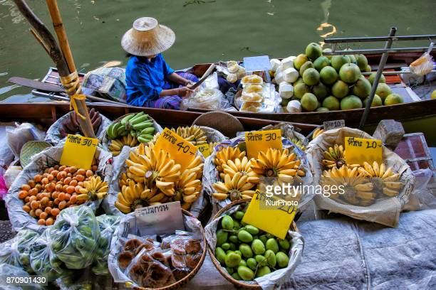 Early morning images in Damnoen Saduak Floating Market in Ratchaburi district Thailand Colorful trader's boats in the floating markets one of the...