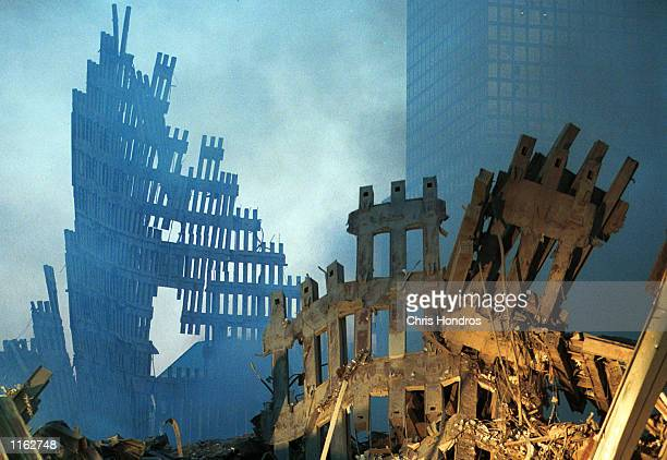 Early morning light hits the smoke and wreckage of the World Trade Center September 13 2001 in New York City two days after the twin towers were...
