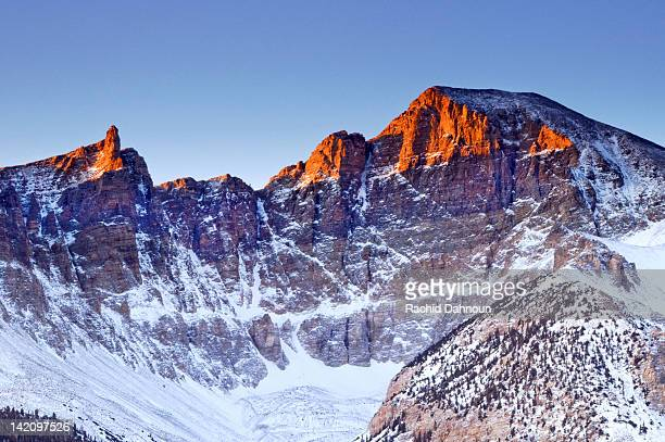 early morning light illuminates wheeler peak in great basin national park. - great basin stock pictures, royalty-free photos & images