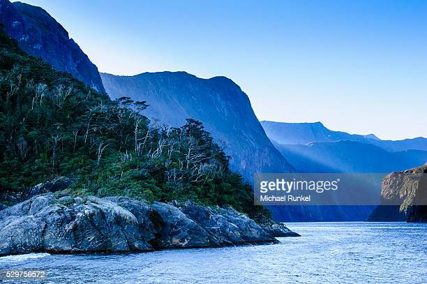 early morning light in milford sound, fiordland national park, unesco world heritage site, south island, new zealand, pacific - international landmark stock pictures, royalty-free photos & images
